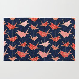 Red origami cranes on navy blue Rug