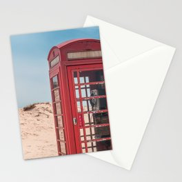 A vintage British red telephone box in the sand dunes of a deserted beach Stationery Cards