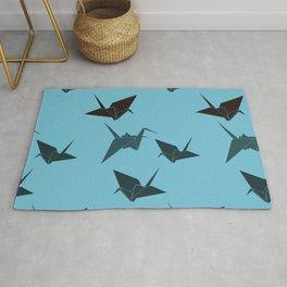 Blue origami cranes Rug
