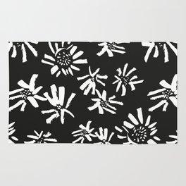 White Flowers On The Black Rug