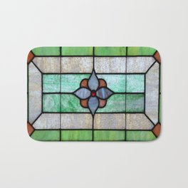 Stained Glass features a picture of a classic stained glass window typically found above a door Bath Mat