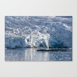 Ice art by nature on glacier and in ocean Canvas Print