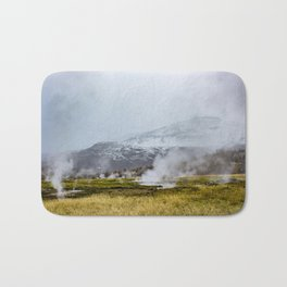 Steam Rising from the Strokkur Geysir Field in Iceland with Mountains in the Background Bath Mat