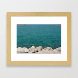 The calming beach view Framed Art Print