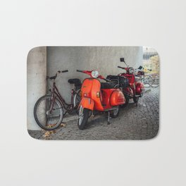 Red scooters in Berlin Bath Mat