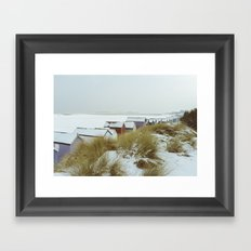 Sand dunes and beach huts in snow. Wells-next-the-sea. Framed Art Print