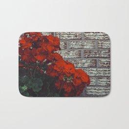 Red bricks red flowers Bath Mat