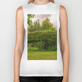 a bridge is covered with leafs and branches Biker Tank