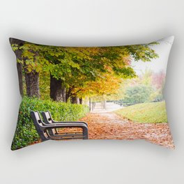 Park bench surrounded by fallen leaves during Autumn Rectangular Pillow