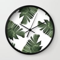 banana leaf Wall Clocks featuring Banana Leaf Frenzy #society6 by 83 Oranges™