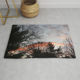 red clouds in the sky Rug