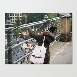 Unknown woman taking a picture in Luxembourg Capitol City (Bridge).I Love Amsterdam cap, Berlin bag Canvas Print