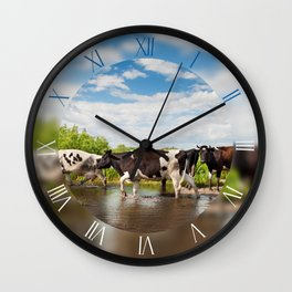 Cows herd walk across puddle Wall Clock