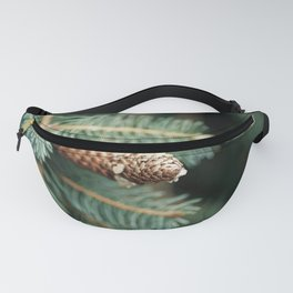 Close up of a pine cone on a pine tree Fanny Pack
