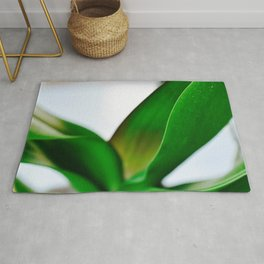 Orchid leaves Rug