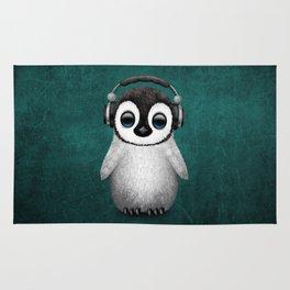 Cute Baby Penguin Dj Wearing Headphones on Blue Rug