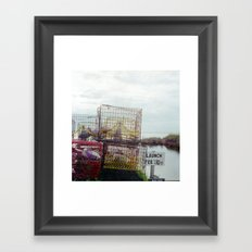 Crab pots at rest Framed Art Print