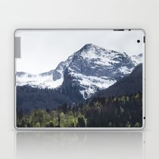 Winter and Spring - green trees and snowy mountains Laptop & iPad Skin