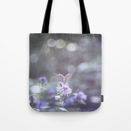 Sun rays and bokeh effect over the butterfly Tote Bag