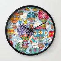 hot air balloon Wall Clocks featuring Hot Air Balloon by Helene Michau