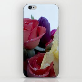 Vibrant bouquet of flowers in the snow iPhone Skin