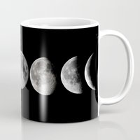 moon phases Mugs featuring Phases of the Moon by Efty