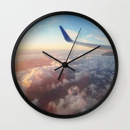 flight over the clouds Wall Clock