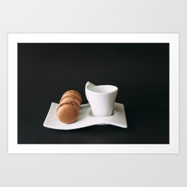 Set of cup of coffee and macaroons against black background Art Print