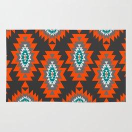 Ethnic shapes on dark background Rug