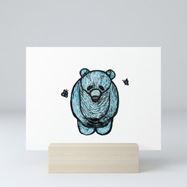 Sad blue bear being taunting by butterflies Mini Art Print