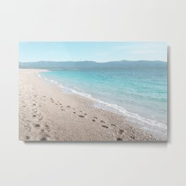 White sandy beach with blue sea, mountains in the back Metal Print