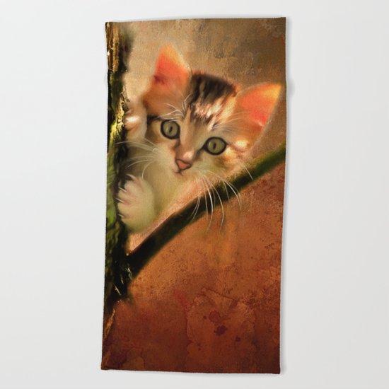 Little cute kitten on a tree Beach Towel