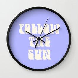 follow the sun - purple Wall Clock