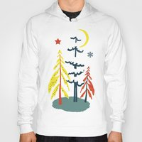skiing Hoodies featuring Retro Skiing  by beach please