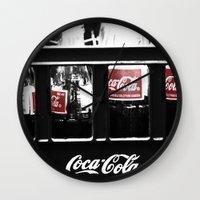 coca cola Wall Clocks featuring coca cola by Crimson Crazed