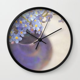 Forget me nots in blue vase. Wall Clock