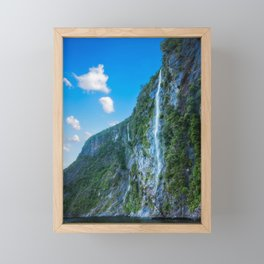 One of the numerous waterfalls falling down the sheer cliffs at Milford Sound. Framed Mini Art Print