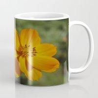 rileigh smirl Mugs featuring Orange Flower by Rileigh Smirl