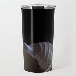 A spiraling sea shell is captured aganst a black background Travel Mug