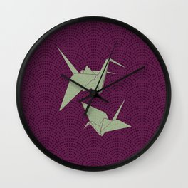 Origami paper cranes on purple waves Wall Clock