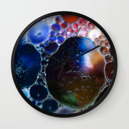 Blue to red bubbles Wall Clock