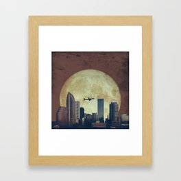 Composited Cityscape with Moon and Plane Framed Art Print