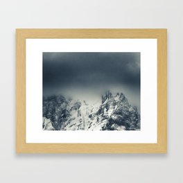 Darkness and clouds covering mountain Framed Art Print