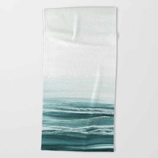 hazy emerald sea Beach Towel