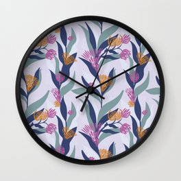 Delicate trailing floral design on a soft mauve base Wall Clock