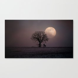 Father and Child Under a Winter Moon Canvas Print