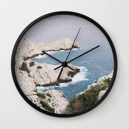 BODY OF WATER BESIDE WHITE ROCK FORMATIONS Wall Clock