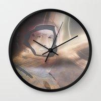 interstellar Wall Clocks featuring Interstellar by Itxaso Beistegui Illustrations