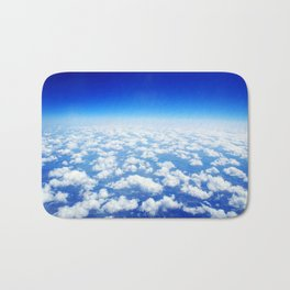 Looking Above the Clouds Bath Mat