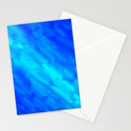 Glowing metallic blue fragments of yellow crystals on irregularly shaped triangles. Stationery Cards